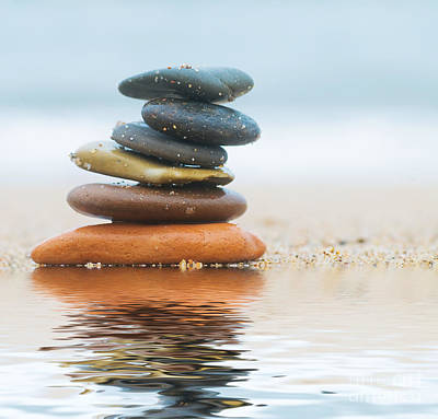 Beach Royalty-Free and Rights-Managed Images - Stack of beach stones on sand by Michal Bednarek
