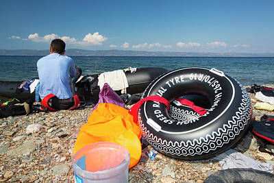 Inflatable Boats Photograph - Syrian Refugees Arriving On Greek Island by Ashley Cooper