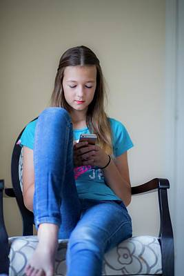 Teenage Girl Using Smartphone Art Print by Samuel Ashfield