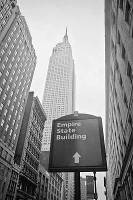New York Signs Photograph - The Empire State Building In New York City by Ilker Goksen