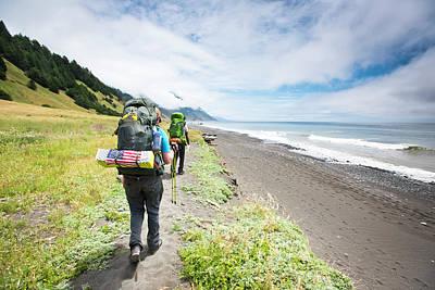 Tow Backpackers Hiking Near The Ocean Art Print