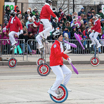 Unicyclists At A Parade Art Print