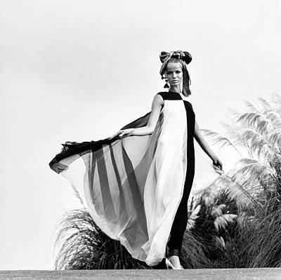 Photograph - Veruschka Wearing A Teal Traina Dress by Franco Rubartelli