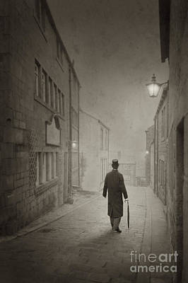 Gas Lamp Photograph - Victorian Man In Top Hat On A Cobbled Street by Lee Avison