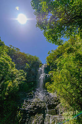 Colorful People Abstract Royalty Free Images - Wailua Falls in a lush tropical valley Maui Hawaii USA Royalty-Free Image by Don Landwehrle