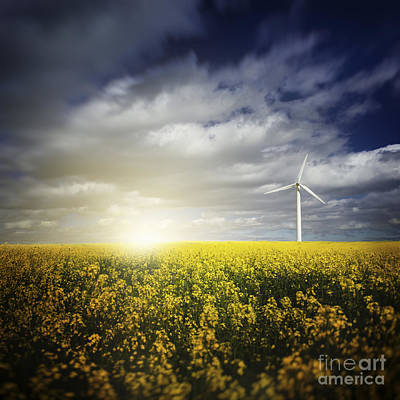 Clouds Over Pasture Photograph - Wind Turbine In A Canola Field by Evgeny Kuklev