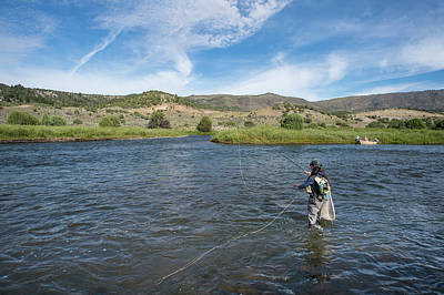 Colorado Fly Fishing River Wall Art - Photograph - Woman Fishing In River, Colorado, Usa by Jennifer Magnuson