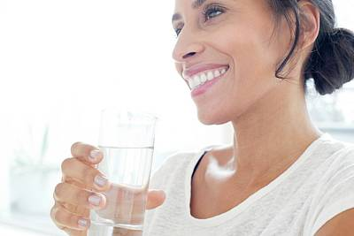 Woman With Glass Of Water Art Print by Science Photo Library