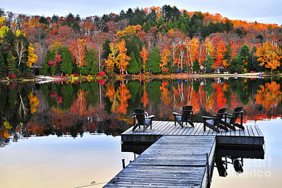Guns Arms And Weapons - Wooden dock with chairs on autumn lake by Elena Elisseeva