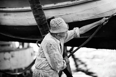 Artist Working Photograph - Working On The Boat by John Rizzuto
