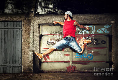 Posing Photograph - Young Man Jumping On Grunge Wall by Michal Bednarek