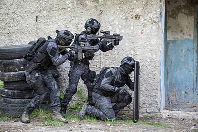 Photograph - Spec Ops Police Officers Swat In Black by Oleg Zabielin