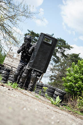Photograph - Spec Ops Police Officers Swat In Black by Oleg Zabielin