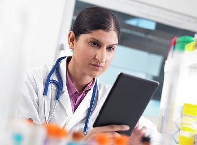 Healthcare And Medicine Photograph - Doctor Using A Digital Tablet by Tek Image