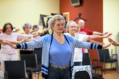 Aging Photograph - Exercise Class For Active Elderly by Alex Rotas