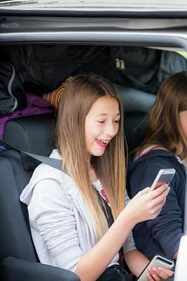 Girl Using Smartphone In Car Art Print by Samuel Ashfield