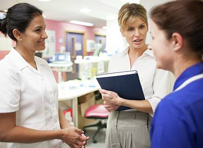 Physiotherapist Photograph - Hospital Staff by Science Photo Library