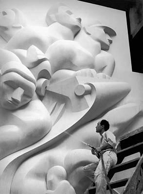 Isamu Noguchi Working Art Print by Underwood Archives