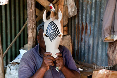 Labour Photograph - Kenya. December 10th. A Man Carving Figures In Wood. by Michal Bednarek