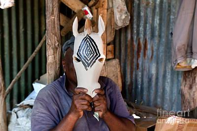 Action Photograph - Kenya. December 10th. A Man Carving Figures In Wood. by Michal Bednarek