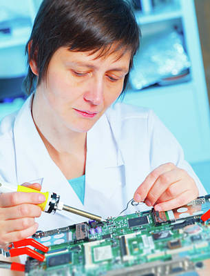 Lab Assistant Working On Circuit Board Art Print