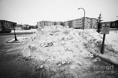 Snow Removal Photograph - large pile of snow for collection cleared from residential streets Saskatoon Saskatchewan Canada by Joe Fox