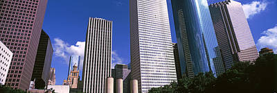 Airlines Photograph - Low Angle View Of Buildings In A City by Panoramic Images