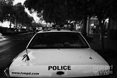 Patrol Cars Photograph - metro metropolitan police squad patrol police car Las Vegas Nevada USA by Joe Fox