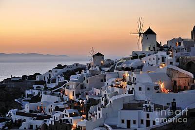 Sunset Wall Art - Photograph - Oia Town During Sunset by George Atsametakis