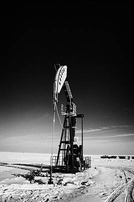 oil pumpjack in winter snow Forget Saskatchewan Art Print