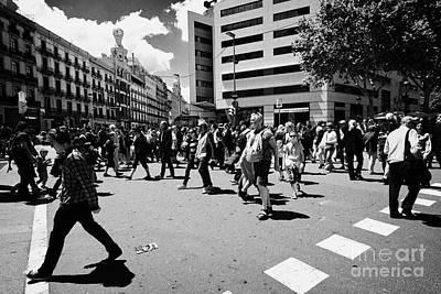 People Walking Across Busy Pedestrian Crossing Placa De Catalunya Barcelona Catalonia Spain Art Print by Joe Fox