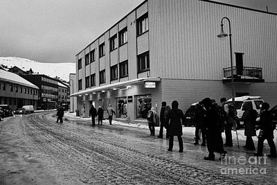 people walking along ice covered storgata main shopping street Honningsvag finnmark norway europe Art Print by Joe Fox