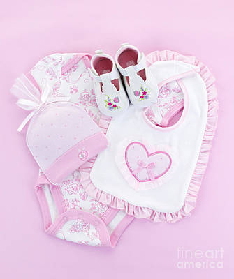 Royalty-Free and Rights-Managed Images - Pink baby clothes for infant girl by Elena Elisseeva