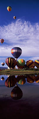 Festival Photograph - Reflection Of Hot Air Balloons by Panoramic Images