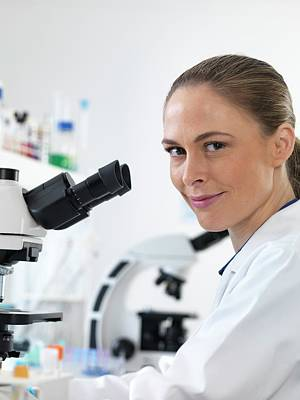 Technician Photograph - Scientist With Microscope by Tek Image
