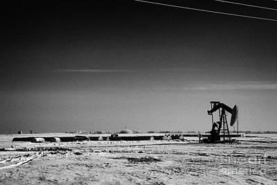 snow covered prairie agricultural farming land with pumpjacks oilfield winter Forget Saskatchewan Ca Art Print by Joe Fox
