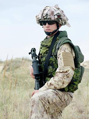 Photograph - Soldier In Desert Uniform Holding by Oleg Zabielin