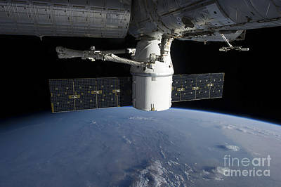 Fantasy Royalty-Free and Rights-Managed Images - Spacex Dragon During Its Docking by Stocktrek Images