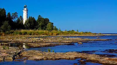 The Cana Island Lighthouse In Baileys Harbor Reflective Waters. Art Print by Carol Toepke