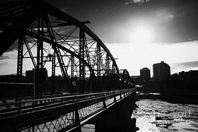 the old traffic bridge over the south saskatchewan river in winter flowing through downtown Saskatoo Art Print by Joe Fox