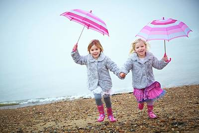 Two People Holding Hands Photograph - Two Girls On Beach Holding Umbrellas by Ruth Jenkinson