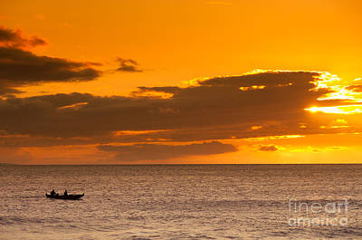 Photograph - Two Men Paddling A Hawaiian Outrigger Canoe At Sunset Maui Hawaii Usa by Don Landwehrle