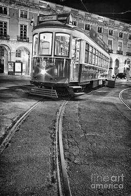 Black Commerce Photograph - Typical Lisbon Tram In Commerce Square by Jose Elias - Sofia Pereira
