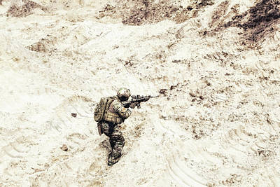Photograph - U.s. Commando Carrying Out A Mission by Oleg Zabielin