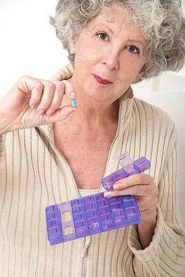 Pill Box Photograph - Woman Holding Pill And Pill Container by Lea Paterson