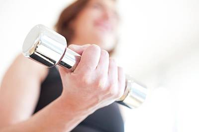 Woman Using Hand Weight Art Print by Ian Hooton