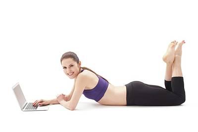 Leggings Photograph - Woman Using Laptop by Ian Hooton