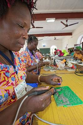 Soldered Photograph - Women On A Solar Workshop by Ashley Cooper