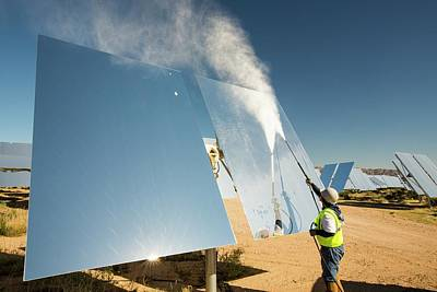 Workers Washing The Heliostats Art Print by Ashley Cooper