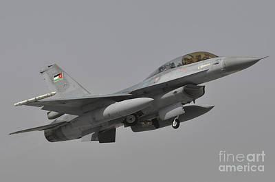 Jordanian Photograph - A Royal Jordanian Air Force F-16am by Giorgio Ciarini